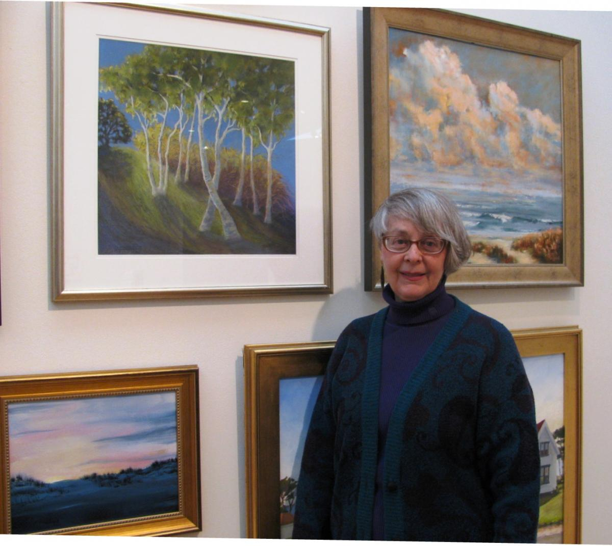 Sybil with her painting at NBMA